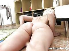 Nasty blonde rolls around in her piss