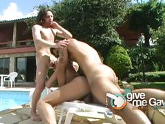 Hot latino studs fucking in threesome by the pool.