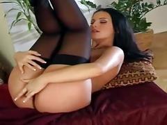 Beautiful brunette masturbates in black nylon