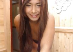 A gorgeous asian shemale doll is teasing naked and then jerking her huge pecker on webcam