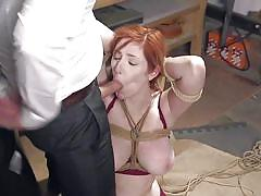 Bound slave gags on big cock