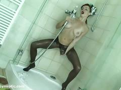Hot contortionist babe posing in the shower