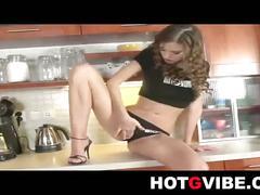 Eufrat masturbates her pussy in the kitchen