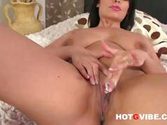 Busty eve diamond shows her big tits