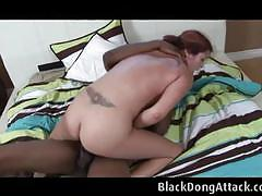 Redhead with ponytails loves to ride a black cock.