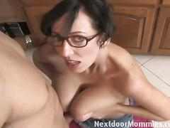 Big breasted nerdy mom strokes a black cock