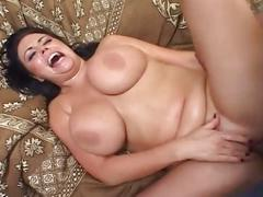 Busty brunette gets two hard cocks for her pleasure