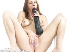 Amateur taking a brutal dildo extremely deep
