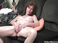 Nasty older woman having fun with big dildos