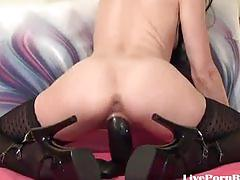 She fucks her pussy with a huge black toy2.wmv