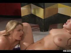 Blonde slut munches a sexy brunette's cunt