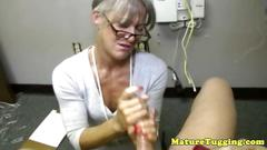 Granny tugs on a strapping lads massive cock