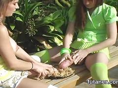 Two futanari teens cum hard while rubbing their strap ons outside