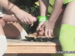 Two futanari teens cum hard while rubbing their strap ons outside