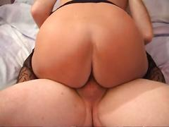 Hot shorthaired mature cougar in stockings rides cock