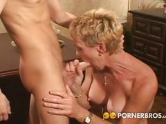 Sexy short haired blonde milf enjoys young cock.