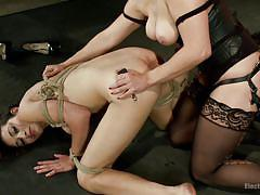 Milf gets fucked with a strap on dildo