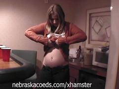 Naked pregnant girl in hotel room