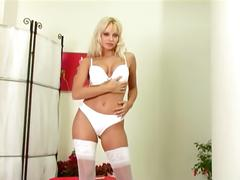 Blonde wearing lingerie fingering her shaved pussy