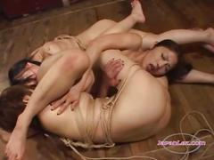 2 bondaged slave girls licking and fingering...