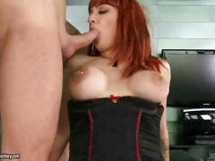 Busty redhead riding two cocks