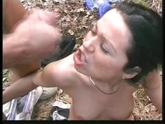 Gorgeous brunette with nice tits gets fucked and sucks dick in the woods