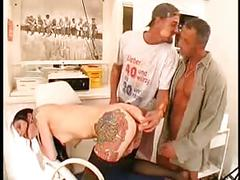 Pierced and tattooed german slut taking on two cocks