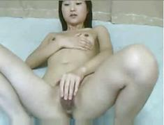 Skinny chinese girl fingers herself