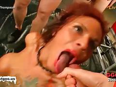 Sexy redhead enjoying a bukkake orgy