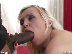 Black stud pounds a blonde into a massive orgasm