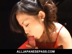 Japanese babe in a fancy dress sucks a mean dick