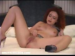 Julia drilling her pussy hole with her long white brutal dildo
