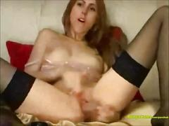 Cam girl in stockings can't get enough of masturbating her pussy