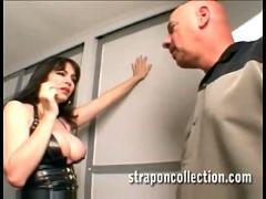 Milf fucks her husband with a huge strapon dildo