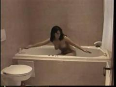 Brunette pleasures herself in the shower