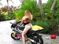 Big booty cutie gets on a bike and cock
