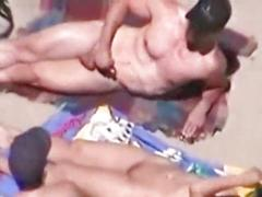 Impassive woman on nude beach lets men spew on her