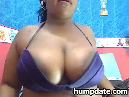 Chubby ebony with massive breasts teasing