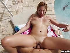 Dick drilling a busty babe poolside