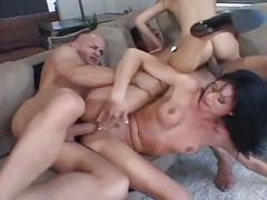 Hot girl enjoys group sex.