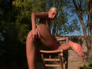 Busty blonde touching