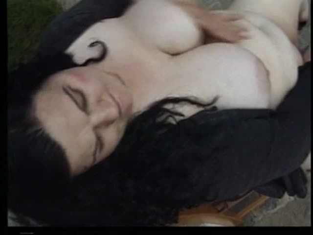 Voluptuous brunette fucks her horny pussy outdoors