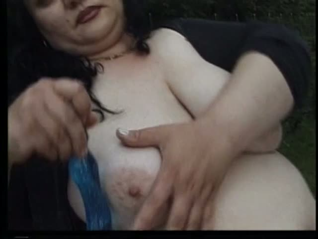 Voluptuous brunette fucks her horny pussy outdoors
