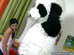 Brunette sucks a huge black dick toy panda.