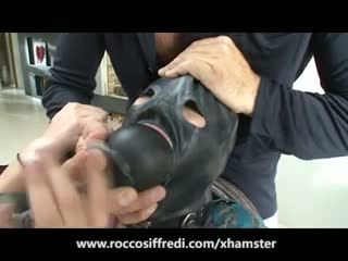 Rocco siffredi face fucks a masked girl and her friend