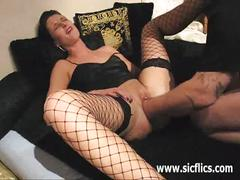 Mature babe with stockings gets her pussy fisted.