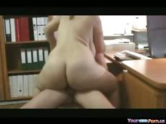 Busty secretary in the office