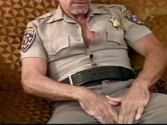 Muscled daddy bears in uniform stretching their mouth with cocks