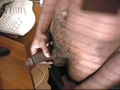 Hot and horny black stud strokes big cock
