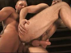 Hairy studs pounding ass in workshop